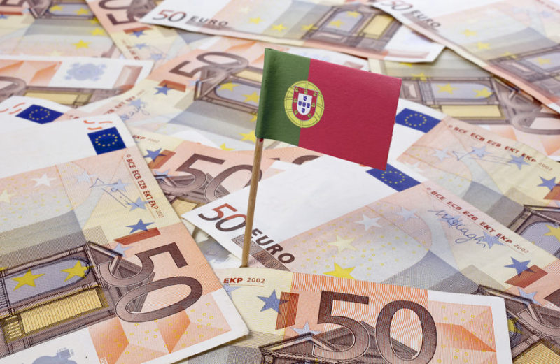 35446734 - flag of portugal sticking in european banknotes.(series)
